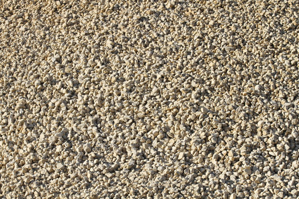 Sandy-colored asphalt and concrete gravel.
